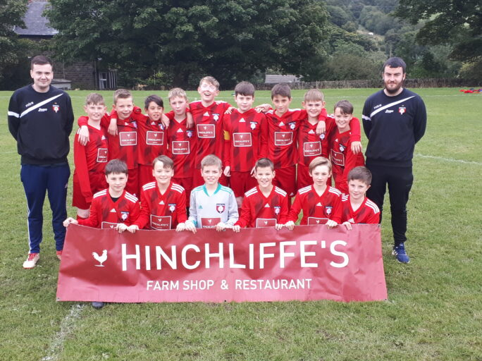 Our U12 group sporting brand new home kit – onwards and upwards