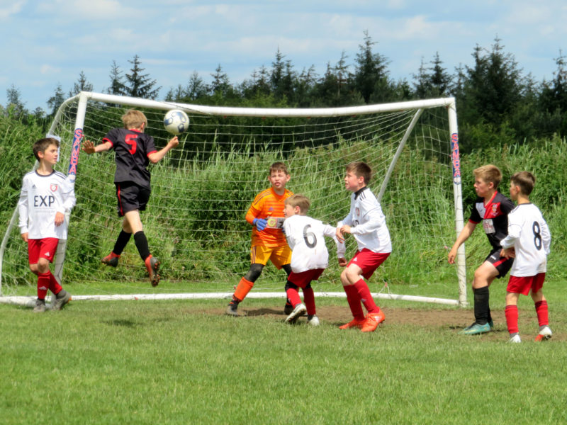 U10's defend against flying header in PPG Cup