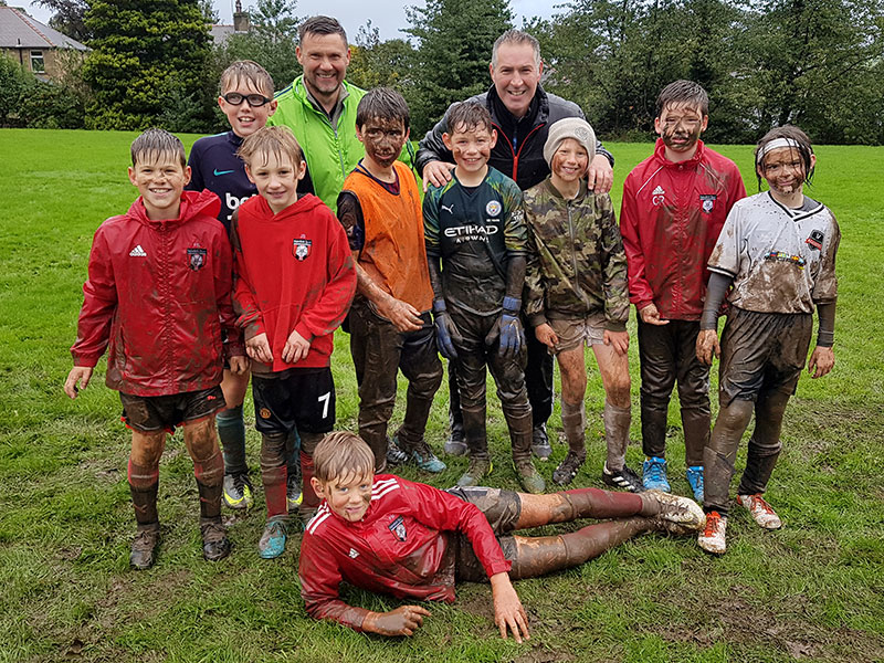 Under 11's after training in torrential rain