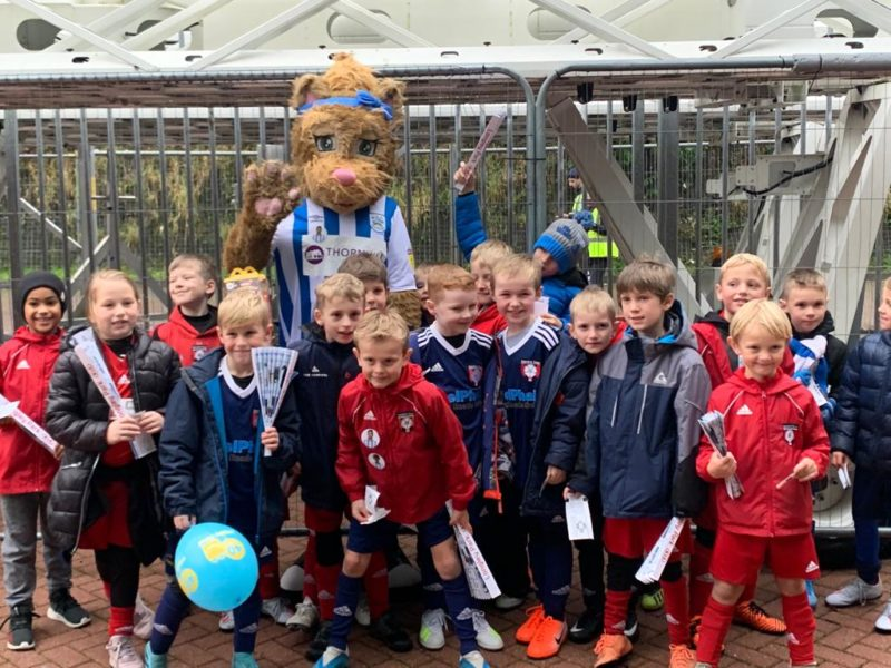 Under 8's with Tilly the Terrier at Huddersfield Town
